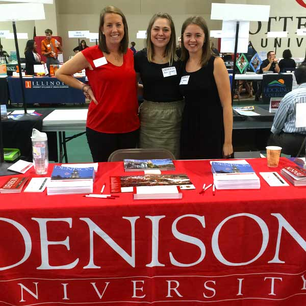Three Admission Ambassadors at a college fair